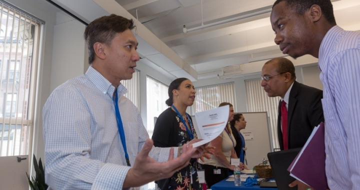 Two men talking at a career fair
