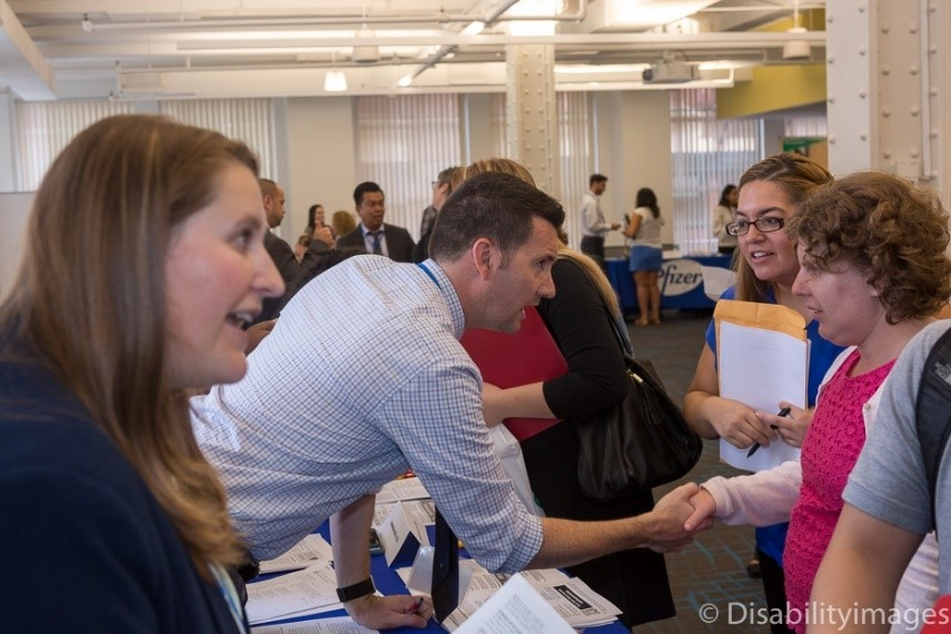 Man shaking hands with female at a career fair