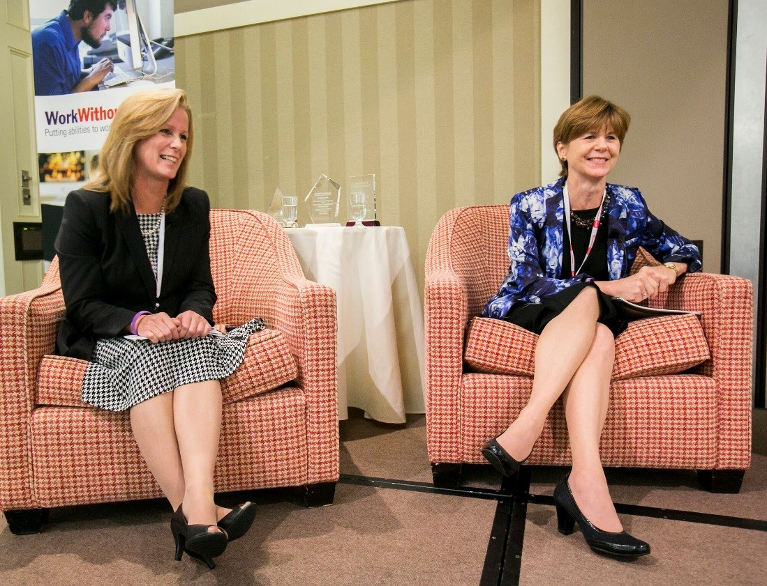 Kathy Petkauskos and Alexis Henry sitting in chairs on stage at the 2013 Raise the Bar HIRE conference