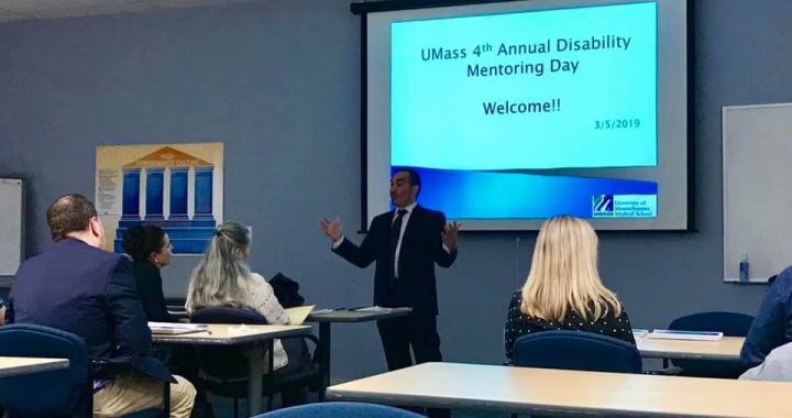 man in front of powerpoint that says umass 4th annual disability mentoring day