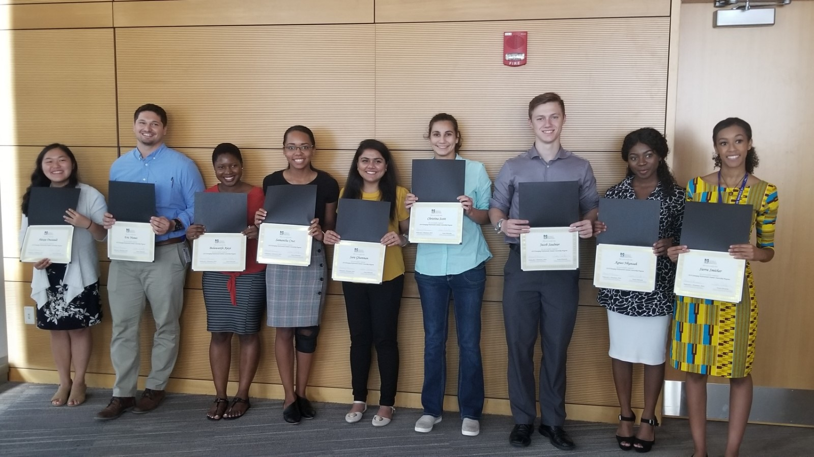 Group of interns with certificates of completion